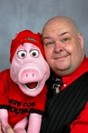 Neale Bacon with PIG puppet.